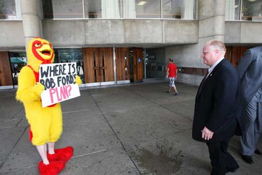 A the chicken-suited volunteer from the George Smitherman campaign turned up during a press conference today to once again taunt Ford for failing to take part in a live radio debate with the former deputy premier. (MICHAEL PEAKE, Toronto Sun)
