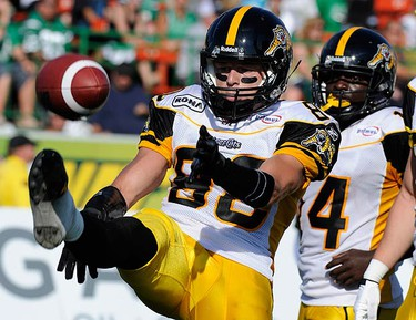 Hamilton Tiger-Cats' Dave Stala (L) celebrates his second-quarter touchdown against the Saskatchewan Roughriders during Canadian Football League action in Regina, July 31, 2010. REUTERS/Fred Greenslade (CANADA - Tags: SPORT FOOTBALL)