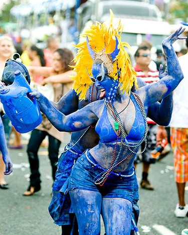Gloria Roheim in the Blue Devil mas band in the annual Caribana Parade in Toronto on July 31, 2010.  The parade sees thousands upon thousands of revelers flood Lake Shore Blvd. with floats, dancers and loud Caribbean music. (ERNEST DOROSZUK, Toronto Sun)