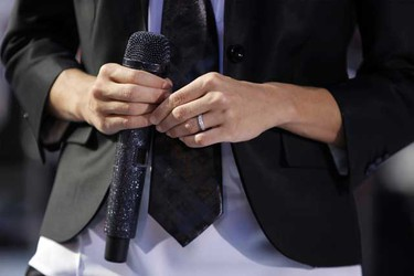 Singer Carrie Underwood holds a microphone and shows her wedding ring after performing on NBC's Today Show in New York July 30, 2010. (REUTERS)