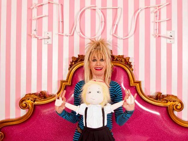 Designer Betsey Johnson poses for a portrait inside the Eloise Suite at the Plaza hotel in New York July 29, 2010. Designed by Johnson the elaborate $995 a night room, based on the fictional character Eloise, on the 18th floor features zebra-print carpet, pink striped walls, a king-size bed with plenty of pillows --in case a pillow fight strikes your fancy-- and even a tiny kitchenette stocked with candy and pink glasses. Picture taken July 29, 2010.  (REUTERS)