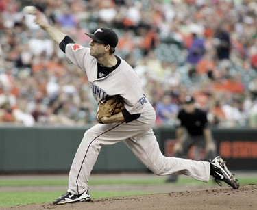 Toronto Blue Jays starting pitcher Brandon Morrow delivers a pitch against the Baltimore Orioles in the first inning of their MLB American League baseball game in Baltimore, Maryland, July 17, 2010.   (REUTERS)