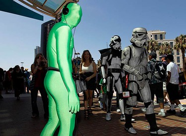 """Attendees arrive dressed as """"Stormtroopers"""" for the third day of the pop culture convention Comic Con in San Diego, California July 24, 2010.  (REUTERS)"""