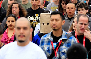 Attendees make their way to Comic Con in San Diego, California July 24, 2010.  (REUTERS)