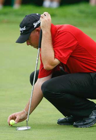 Ted Brown of Calgary pace his putt on the sixth hole at the second round of the 2010 RBC Canadian Open at St George's Gold Club in Toronto July 23, 2010. (Michael Peake/QMI Agency)