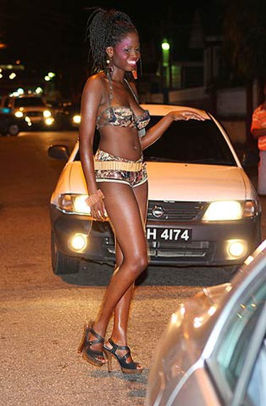 A model wearing a design from PILAR by Anya Ayoung-Chee stops traffic on a street in Woodbrook, Port of Spain, in this July 22, 2010 picture. The fashion show was part of the second annual Erotic Art week and was held to acknowledge people who walk the streets as some areas in Woodbrook are known for prostitution. Erotic Art Week ends on July 31, 2010.  (REUTERS)