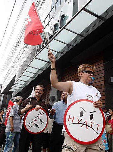 Protesters from Local 75 march outside of the Hyatt Regency Toronto on King St. near John St. in Toronto on July 22, 2010. They claim the hotel chain is trying to make the recession permanent for workers. (DAVE ABEL, Toronto Sun)