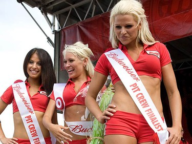 Winner Theresa with Sam and Gillian (right) during the Bud Pit Crew pageant held at the Exhibition Grounds in Toronto on July 17, 2010. (DAVE THOMAS, Toronto Sun)