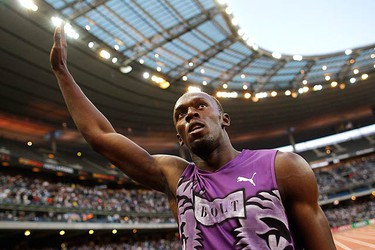 Usain Bolt of Jamaica reacts after he won the men's 100 meters at the IAAF Diamond League athletics meeting at the Stade de France Stadium in Saint-Denis, near Paris July 16, 2010. (REUTERS)