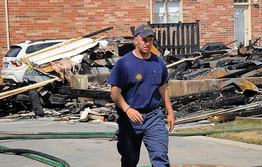Ontario Fire Marshal investigator Mike Ross checks out the rear of a home on Morning Dove Dr. that was flattened in an explosion just after midnight Wednesday. (CHRIS DOUCETTE, Toronto Sun)