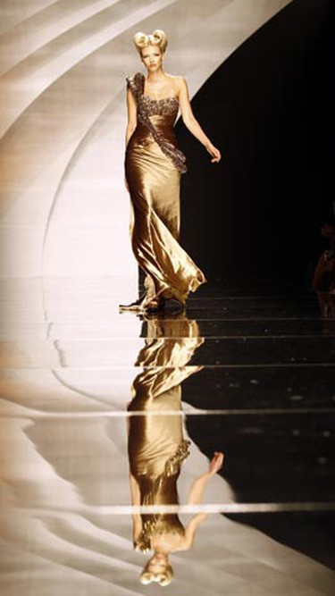 A model displays a creation as part of Lebanese designer Abed Mahfouz's collection during Fashion Week in Rome July 13, 2010. (Alessandro Bianchi/REUTERS)
