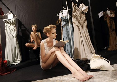 A model reads a book as she waits backstage before Lebanese designer Abed Mahfouz's show during Fashion Week in Rome July 13, 2010. (Alessandro Bianchi/REUTERS)