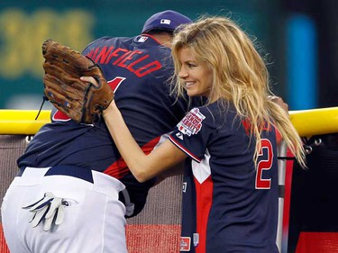 Model Marisa Miller consoles Hall of Famer Dave Winfield (L) at the fence after former all-star Fred Lynn hit a homerun during the Legends and Celebrities All Star softball game at Angel Stadium in Anaheim, California July 11, 2010. The 2010 Major League All Star Game will be played at the Angel Stadium on Tuesday.      (REUTERS)