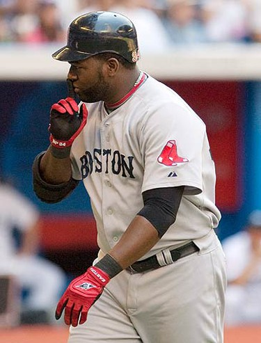 Boston Red Sox David Ortiz gestures after hitting a home run against the Toronto Blue Jays during the sixth inning of their MLB American League baseball game in Toronto, July 11, 2010.  (REUTERS)