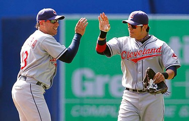 Cleveland Indians Asdrubal Cabrera (L) and Shin-Soo Choo celebrate defeating the Toronto Blue Jays in their MLB American League baseball game in Toronto, August 1, 2010. (REUTERS)