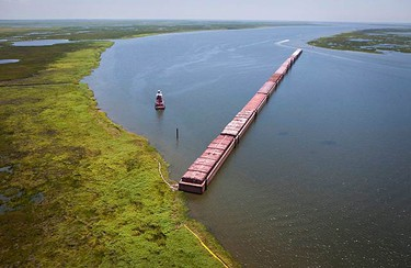 Barges are positioned to protect against oil from the Deepwater Horizon spill in a major waterway leading to Lake Pontchartrain near Slidell, Louisiana July 8, 2010. (REUTERS)