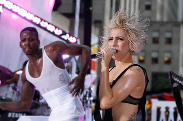 """Singer Lady Gaga performs during a rain shower on NBC's """"Today"""" show in New York, July 9, 2010.  (REUTERS)"""