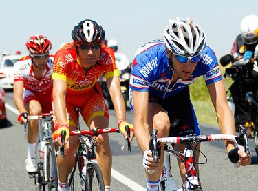 Cofidis' Julien El Fares of France (L), Caisse D'epargne's Jose Ivan Gutierrez of Spain (C) and Quick Step's Jurgen Van De Walle (R) of Belgium cycle during their three-man breakaway at the fifth stage of the Tour de France cycling race between Epernay and Montargis, July 8, 2010.  (REUTERS)