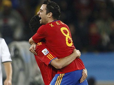 Xavi (Spain): One of the best pure passers in recent memory. He is the straw that stirs the Spanish drink, a beverage that likely will be champagne with a victory in the final Sunday. (REUTERS/Eddie Keogh)