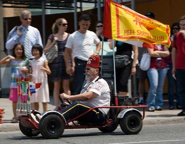 About 10,000 Shriners descended upon Toronto for the 2010 Imperial Session on July 6, 2010. The  fun-loving philanthropic fraternity paraded down University Ave. in various modes of transport.  (Jack Boland/QMI Agency)