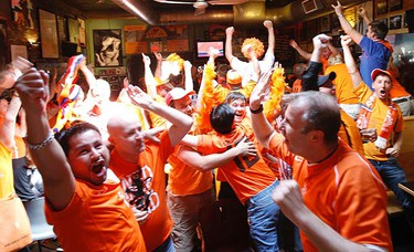 Dutch fans were delirious at Betty's on King St. E. following their come from behind 2-1 win over Brazil. Betty's has become the Dutch headquarters for this summer's World Cup. (JACK BOLAND, Toronto Sun)