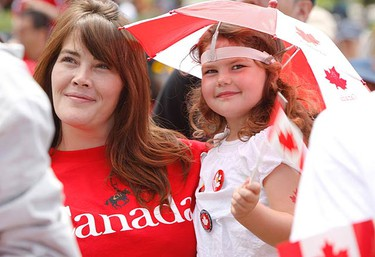 Trina Crehore and her daughter Anika, 4, of Toronto, celebrate on the front lawn at Queen's Park on July 1, 2010. (JACK BOLAND, Toronto Sun)