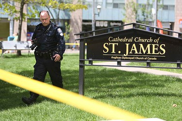 Photos from the scene at St. James Cathedral where worshipers are in shock after the body of a man was found outside the 157-year-old church on Canada Day. (VERONICA HENRI, Toronto Sun)
