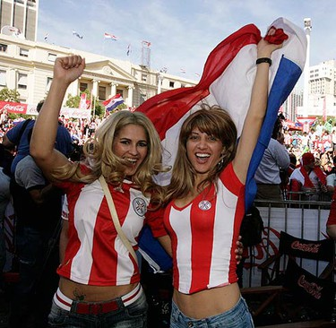 Paraguayans celebrate after their national soccer team tied with New Zealand to qualify for the round of 16 at the 2010 World Cup in South Africa, in downtown Asuncion June 24, 2010.  (REUTERS)