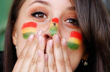 A Ghana fan clutches her face in the dying moments of an opening round game at the 2010 World Cup in South Africa. (REUTERS)