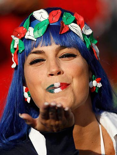 An Italian fan blows a kiss as she waits for the start of the 2010 World Cup Group F soccer match between Slovakia and Italy at Elis Park stadium in Johannesburg June 24, 2010.   (REUTERS)