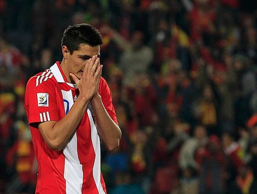 Paraguay's Oscar Cardozo reacts after his penalty kicked was saved by Spain's goalkeeper Iker Casillas during the 2010 World Cup quarter-final soccer match at Ellis Park stadium in Johannesburg July 3, 2010. (REUTERS)