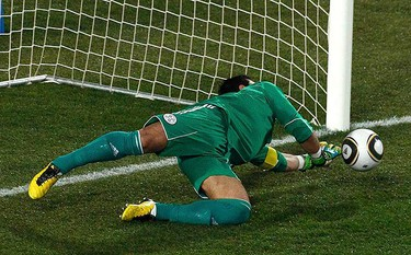 Paraguay's goalkeeper Justo Villar saves a penalty shot during their 2010 World Cup quarter-final soccer match against Spain at Ellis Park stadium in Johannesburg July 3, 2010. (REUTERS)
