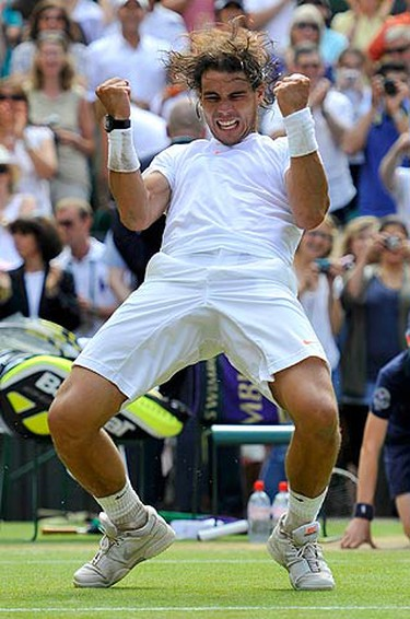 Spain's Rafael Nadal celebrates defeating Tomas Berdych of the Czech Republic in the men's singles final at the 2010 Wimbledon tennis championships in London, July 4, 2010.  (REUTERS)