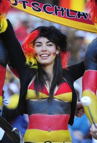 A Germany supporter cheers prior to the start of the Group D first round 2010 World Cup football match Germany vs. Serbia on June 18, 2010 at Nelson Mandela Bay stadium in Port Elizabeth.AFP PHOTO / JOHN MACDOUGALL