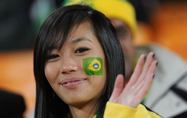 A supporter of Brazil waves before the start of the 2010 World Cup group G first round football match between Brazil and Ivory Coast on June 20, 2010 at Soccer City stadium in Soweto, suburban Johannesburg. AFP PHOTO / GABRIEL BOUYS