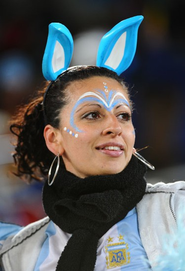 An Argentina supporter cheers prior to the start of the Group B first round 2010 World Cup football match Greece vs. Argentina on June 22, 2010 at Peter Mokaba stadium in Polokwane.  AFP PHOTO / FRANCOIS-XAVIER MARIT