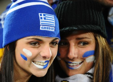 Greece's supporters smile in the tribune prior the Group B first round 2010 World Cup football match Greece vs Argentina on June 22, 2010 at Peter Mokaba stadium in Polokwane. AFP PHOTO / FRANCOIS-XAVIER MARIT