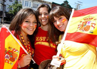 Spanish fans Monica, Navia and Anvrijana celebrate outside Plaza Flaminco restaurant on College St, after Spain qualified for the next round of World Cup of Soccer, June 25, 2010. (Alex Urosevic/QMI Agency)