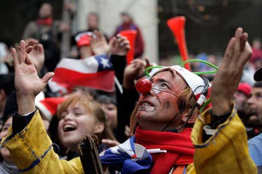 Chilean fans celebrate at the end of their 2010 World Cup Group H soccer match against Spain, in Santiago June 25, 2010.  (REUTERS)