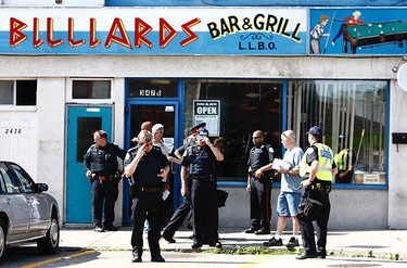 The scene outside the Pegasus Billiards Bar & Grill, on Danforth Ave. shortly after a gunman opened fire on two men. (JACK BOLAND, Toronto Sun)