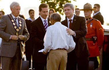 Canadian Prime Minister Stephen Harper, Ontario premier Dalton McGuinty and Toronto Mayor David Miller shakes hands with Dr. Bal Gupta of the Air India Victims' Family Association. Gupta lost several family members including his wife. (Jack Boland/QMI Agency)
