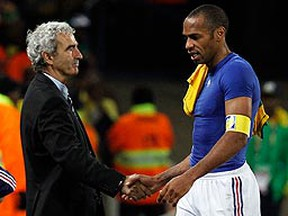 France's Thierry Henry shakes hands with head coach Raymond Domenech after a loss to South Africa in the 2010 World Cup. (REUTERS/Jorge Silva)