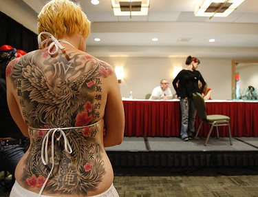 Theresa of Courticve waits to have her astrological back tattoo inspected by the judges. (JACK BOLAND, Toronto Sun)