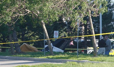 A light aircraft sits in a wooded parking lot in front of an office building at 45 Vogell Rd. It's reported that the aircraft crashed after taking off from Buttonville Airport, possibly killing its lone occupant on June 20, 2010. (JACK BOLAND, Toronto Sun)