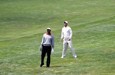 Tiger Woods (R) of the U.S. and Vijay Singh of Fiji look to the sixth green from the fairway during the third round of the U.S. Open Golf Championship in Pebble Beach, California, June 19, 2010. (REUTERS)
