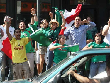 Mexican fans celebrate their 2-0 win over France on Bloor St. near Dufferin, in Toronto. (CRAIG ROBERTSON/QMI Agency)