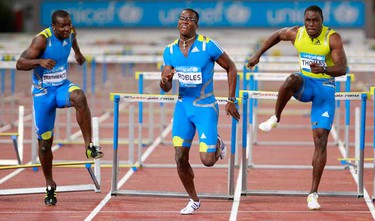 Dayron Robles of the U.S. (C) clears a hurdle to win the 110m Hurdles Men event, ahead of Ryan Brathwaite of Barbados (L) and Dwight Thomas of Jamaica, at the IAAF Diamond League athletics meeting in Rome June 10, 2010.   (REUTERS)
