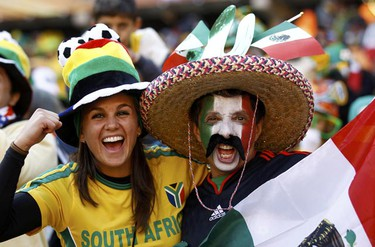 Fans of Mexico and South Africa cheer while awaiting the start of the opening ceremony of the 2010 World Cup at Soccer City stadium in Johannesburg June 11, 2010. (Eddie Keogh/REUTERS)