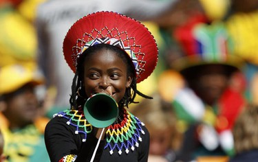 A soccer fan blows a vuvuzela while awaiting the start of the opening ceremony of the 2010 World Cup at Soccer City stadium in Johannesburg June 11, 2010. (Kai Pfaffenbach/REUTERS)