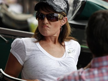 Sarah Palin, seen in the stands of the Belmont Stakes, apparently has new breast implants. (JESSICA RINALDI/Reuters)
